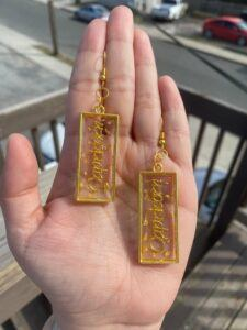 Capricorn gold open bezel rectangle shaped earrings with gold foil